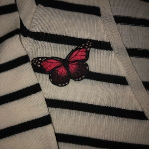 Cream cordial length sweater w/butterflies...